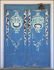 Comedy and Tragedy (Explored) (Runemaker) Tags: amargosa operahouse deathvalleyjunction california comedy tragedy theater theatre opera smile frown happy sad door doorway entrance blue art