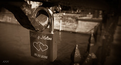 Fatih and Melisa. Locked. (babs van beieren) Tags: lovelock hearts love fence medieval bruges belgium beguinage citytrip fencedfriday cliché