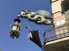 Dragon lamp at the Ramblas in Barcelona (annebethvis) Tags: rambla dragon barcelona sky umbrella boqueria street lamp