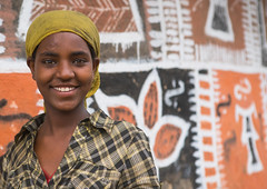 Ethiopian woman standing in front of her traditional painted house, Kembata, Alaba Kuito, Ethiopia (Eric Lafforgue) Tags: abyssinia adult africa alaba architecture art building cheerful color culture cute decorated decoration depiction eastafrica ethiopia ethnic geometric halaba horizontal hornofafrica house hut illustration islam kulito lookingatcamera mural muslim oneperson onewomanonly outdoors painted painting portrait poverty residential ruralscene smile smiling teenager toukoul traditional tukul village waistup woman women ethio163447 alabakuito kembata