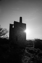 Time Passing By (richardsolway) Tags: engine house enginehouse sun flare sunset setting old peevor wheal cornwall redruth monochrome blackandwhite landscape