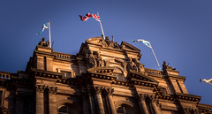 Bank of Scotland (NathanJNixon) Tags: scotland bank building history victorian old historic europe european scottish architecture art decor flags flag british unitedkingdom sunset sunny clear blue orange yellow shadow dark light highlight photography canon dslr depth dusk evening impressive majestic edinburgh urban city street travel town capital sky skyline cityscape hill scene