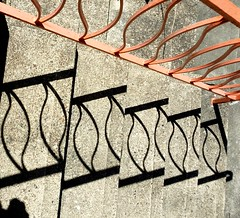 Stoop shadows from the railing (talulahgosh) Tags: pittsburgh railing stair concrete shadow sunshine sunday swissvale woodstock outside orange metal cast castlebrown