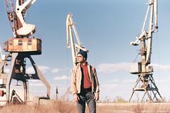 Everything stops... (awaylastdays) Tags: pentax me super pentaxmesuper crane kodak color industrial sky portrait men colors sun spring port ukraine outdoor ua cherkassy cherkasy clouds