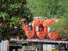 Rolled Orange Hose On A Trailer. (dccradio) Tags: lumberton nc northcarolina robesoncounty outside outdoors tree trees greenery nature trailer semi rig coils rolls orangehose transportation hydrant firehydrant