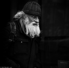 Old codger. (Neil. Moralee) Tags: neilmoralee neilmoraleenikond7200 old codger man face candid portrait black white bw bandw blackandwhite mono monochrome beard moustache street hat wooly mature curmudgeonly grotesque dark neil moralee nikon d7200 grainy gritty city wells somerset rucksack evil sinister tramp homeless destitute rough sleeper unemployed