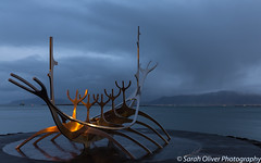 A glimpse of dawn light hitting the Dreamboat (SarahO44) Tags: 6d canon dawn iceland jóngunnar reykjavik sculpture sun sólfar voyager árnason reykjavík capitalregion is viking boat ship sunrise dreamboat outdoors landscape