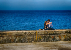 On the Sea Wall - Havana (RG Rutkay) Tags: cuba havana seawall ocean couple kissing outdoor street pda moment young blue concrete scene hdr man woman