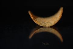 One must be the last... (Inky-NL) Tags: macromondays chips chip reflection ingridsiemons©2017 snack food crispy nachocheesechips pringles blackbackground patatochips minimalism macro