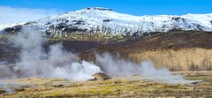 Icelandic Geothermal Hotspot (Herculeus.) Tags: 2017 april clouds country day europe geothermalhotspot geyser haukadalsvegur iceland landscape mountain mountains outdoor outdoors outside spring steam volcanoes