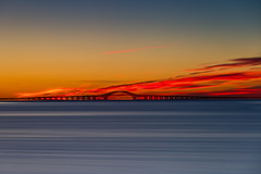 """A Fire in the Sky"" (Bob90901) Tags: fire sky robertmosescauseway greatsouthbay longisland newyork bluehour civiltwilight longexposure rpg90901 dawn sunrise clouds canon 6d canonef70200mmf28lisiiusm canon70200f28lll lee bigstopper nd10 neutraldensity filter water summer lindenhurst venetianshores suffolkcounty bridge bay 2016 september 0605 vle"