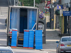 Delivery 2 (M C Smith) Tags: truck telephone box delivery boxes blue crates pentax k3ii parking shopping signs railings hill flowers lamps road shutters