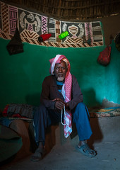 Ethiopian muslim man inside his traditional painted and decorated house, Kembata, Alaba Kuito, Ethiopia (Eric Lafforgue) Tags: abyssinia adult africa alaba architecture art artwork building circular color culture decorated decoration depiction eastafrica ethiopia ethnic fulllenght geometric halaba home hornofafrica house housing hut illustration indoors kulito lookingatcamera man mural onemanonly oneperson painted painting poverty residential round ruralscene toukoul traditional tukul vertical village ethio163416 alabakuito kembata