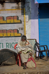 20170312-MVR_1600 (Mivr) Tags: barsana india man sitting blue street
