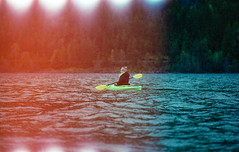 Paddling Kootenay Lake (JeffAmantea) Tags: paddle kayak kootenay kootenays lake west arm bc british columbia canada nelson water trees light leak girl landscape portra 400 kodak nikon fe2 nikkor 100mm 28 nature outdoor outside spring tree wet