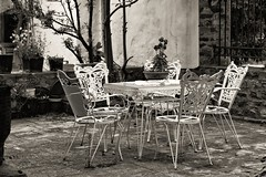Quiet Places. (Blues Views) Tags: agiospanteleimon orthodoxchuch church churchyard seats table plants monochrome macedoniagreece mono stpanteleimon noiretblanc photographieennoiretblanc ναόσαγίουπαντελεήμονα thessaloniki greece chairs blackandwhite makedonia ll