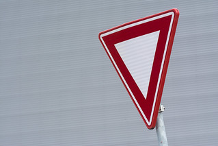 Red sign in front of a grey wall