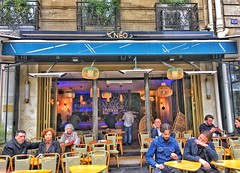 Paris France  ~  Neo Cafe ~  Terrace ~ St Germain ~ Restaurant (Onasill ~ Bill Badzo) Tags: candid colour paris france neo cafe restaurant neocafe terrace patio st germain travel tourist iphonegraphy balcony castiron people watching street scene attraction site historic iphone apple expression face hdr mild europe