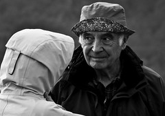 When the wife buys you a hat ! (Neil. Moralee) Tags: neilmoralee svalbardnorwaylongyearbyenneilmoralee couple married man woman husband wife hat stupid odd face portrait life laugh black white street candid svalbard nirway cold toe pair cap blackandwhite bw bandw monochrome nikon d7100 neil moralee 18300mm zoom dispute defeat