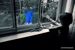 at grandmothers...#FBF (PointOfUPhotography) Tags: hanging clothes hangingclothes mybluedress waiting hangers woodhangers window splashcolor blackandwhite flashbackfriday little girl
