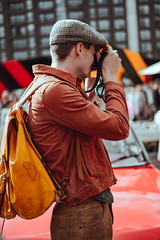 Hipster Photographer - Must Link to https://informedmag.com (Informedmag) Tags: hipster photographer pageboy pageboycap tourist leather earthtones artist canvas
