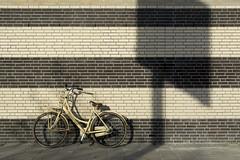Bike and shadow (Jan van der Wolf) Tags: map171254v wall fiets muur bike bicycle shadow shadowplay stripes strepen lines lijnen facade gevel urban leiden