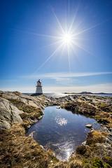 Anstens lighthouse (Richard Larssen) Tags: richard richardlarssen flekkerøya larssen landscape light lighthouse norway norge norwegen nature sony scandinavia sea sky sel1635z sun sunstar sunray sunburst pond