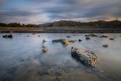 TELL HER ABOUT IT (jopetsy) Tags: sual pangasinan sunrise sunset seascape landscape fujifilm fuji philippines rain rock stones pebbles