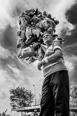 Balloons (Mustafa Selcuk) Tags: 2017 edirne fujifilm travel turkey balloon people man street streetphotography streetphotographer streetshooter blackandwhite bnw bw siyahbeyaz monochromatic monochrome