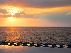 Sunset and Steps Over the Water, Havana Cuba (shaire productions) Tags: sky heavens image picture photo photograph clouds imagery nature water ocean bay cuba cuban havana sun sunset sunrise beauty steps stairs pattern abstract shapes geometric