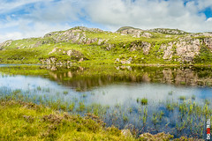 Lakeside Reflection (BigRedTroll) Tags: beautiful beauty cloud cloudy color green hill isolated landscape lush material nature outdoor pool reflection rock rugged scene sky stone verdant water