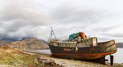 Beached (Mark Alan Andre) Tags: markalanandre scotland travel unitedkingdon boat abandoned ruin beach water mountain ship