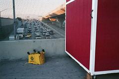Caution (ADMurr) Tags: la 110 overpass homeless hut traffic janitors rolling bucket caution leica m4 50mm summicron film kodak ektarcab788