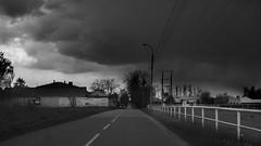 Converging lines (posterboy2007) Tags: road fence clouds storm vanishingpoint converginglines powerlines monochrome bw