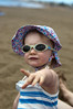 Emily pointing on the beach (dan.oxlade) Tags: d40 nikkor nikkor50mm118g beach child polarisingfilter nikon lanzarote spain holiday