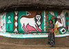 Ethiopian woman standing in front of her traditional painted house, Kembata, Alaba Kuito, Ethiopia (Eric Lafforgue) Tags: abyssinia adult africa alaba architecture art building circular color culture decorated decoration depiction eastafrica ethiopia ethnic geometric halaba home horizontal hornofafrica house hut illustration kulito mural naive oneperson onewomanonly outdoors painted painting poverty residential round ruralscene toukoul traditional tukul village woman women ethio163495 alabakuito kembata