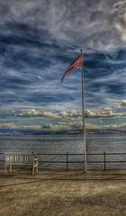 The flag (Roman_P2013) Tags: flag bench hamar norway norge best shot nice clouds lake water blue landscape