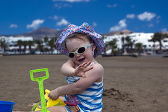 Emily waving (dan.oxlade) Tags: d40 nikkor nikkor50mm118g beach child polarisingfilter nikon lanzarote spain holiday