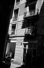 In the window... (elgunto) Tags: street streetphoto streetphotography people contrast light shadows blackwhite bw barcelona elborn sonya7 canonfd28 digitalphoto manuallense