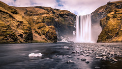Skogafoss waterfall - Iceland - Landscape photography (Giuseppe Milo (www.pixael.com)) Tags: iceland skogafoss landscape waterfall travel nature water outdoor longexposure hill rocks ice southernregion is onsale