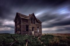 Midwest Farmstead (Jonathan Tasler) Tags: kansas farmstead house clouds prairie longexposure abandoned old broken wood