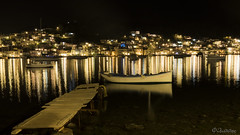 Calm Evening (filippos.pantazis) Tags: poros kalavria evening calm sea island reflections lights yellow dark night boat galatas trizina blue light spot