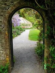 Through the archway - Greenway House, Devon. (daniellewootton) Tags: gate arch nationaltrusthouse grrenwayhouse greenwayhouse nationaltrust devon walledgarden flowers garden