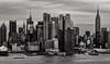 Magnificent Midtown Skyline (LJS74) Tags: manhattan midtown newyorkcity newyork nyc hudsonriver intrepid chryslerbuilding empirestatebuilding skyline skyscraper clouds bankofamericatower monochrome blackandwhite bw architecture