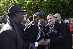 French newly elected president Emmanuel Macron (R) poses for pictures with supporters on May 10, 2017 at the Jardins du Luxembourg in Paris during a ceremony to mark the anniversary of the abolition of slavery and to pay tribute to the victims of the slav