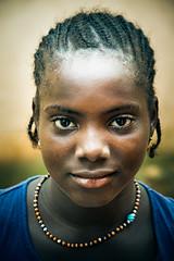 Bissau (Conscious Scofield) Tags: bissau guineabissau guinebissau afro africa african smile happiness children closeup beads beautiful fula fulani child