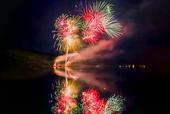 Fireworks (T P Mann Photography) Tags: ngc fire fireworks celebration breezeway ellsworth michigan lake reflections light color bright sky
