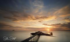 Star Shine. (Explore 23/05/2017) (Sue Sayer) Tags: birnbeck pier clouds yellow pink blue serene golden bright beach water sky night white