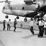 Fall of Saigon - 14 Apr 1975, Xuan Loc - Refugees Hanging on to a Supply Helicopter thumbnail