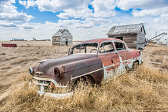 Angle Parking (DeVaughnSquire) Tags: abandoned forgotten rustic rusty scenic landscape vintage old car automobile clouds homestead saskatchewan robsart hood wood grass
